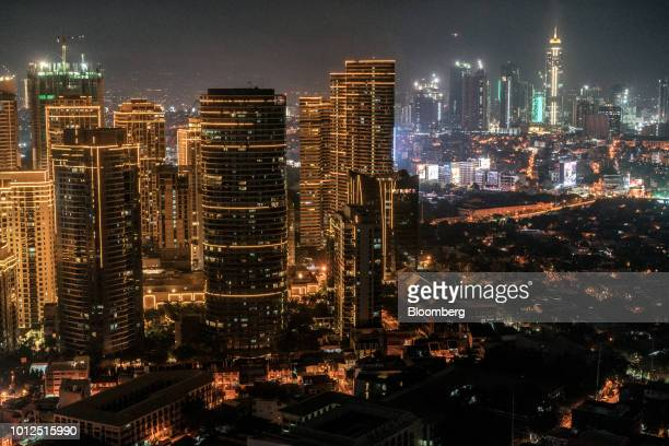 Buildings stand illuminated at night in the Makati district of Manila the Philippines on Saturday Aug 4 2018 Consumer prices in the Philippines...