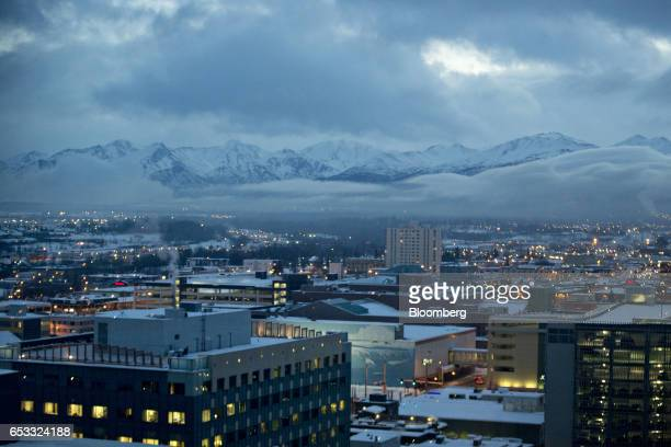 Buildings stand illuminated in front of the Chugach Mountains outside Anchorage Alaska US on Tuesday Feb 14 2017 Four decades after the Trans Alaska...