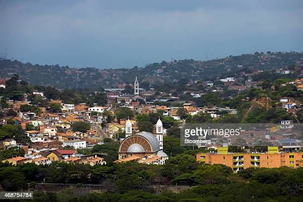 Buildings stand in a residential area of Cucuta, Colombia, on Tuesday, Feb. 24, 2015. Colombia's gross domestic product grew 3.5 percent in the...