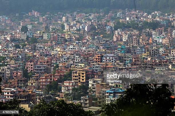 Buildings stand in Kathamandu Nepal on Friday May 29 2015 Nepal's gross domestic product will probably grow 38% in the year through July 15 compared...