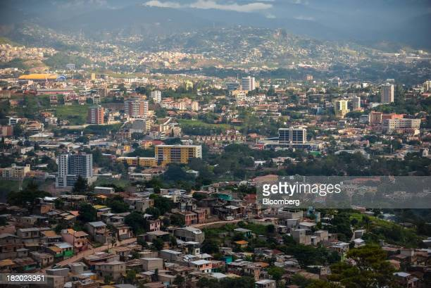 Buildings stand in Tegucigalpa Honduras on Tuesday Sept 3 2013 Economic growth in Honduras is forecast to slow to 3 percent this year from 33 percent...