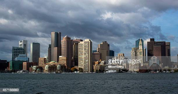 Buildings stand in the city skyline behind the waterfront in Boston Massachusetts US on Tuesday Oct 7 2014 Boston ranked fifth among US cities in the...