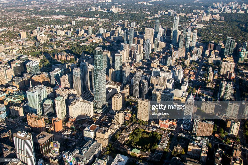 Buildings stand in the downtown skyline in this aerial photograph taken above Toronto, Ontario, Canada, on Monday, Oct. 2, 2017. Toronto housing prices fell for a fourth month in September as sales remained sluggish, particularly in the detached-home segment that has borne the brunt of the correction in Canada's biggest city. Photographer: James MacDonald/Bloomberg via Getty Images