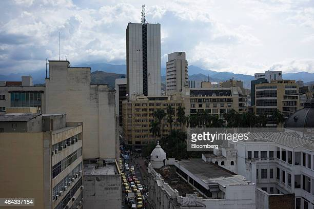 Buildings stand in the financial district of downtown Cali Colombia on Wednesday Aug 12 2015 Colombia's central bank last month cut its forecast for...