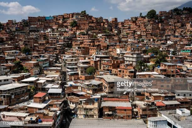 buildings stand in the jose felix ribas neighborhood - カラカス ストックフォトと画像