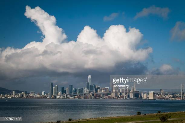 Buildings stand in the San Francisco skyline viewed from the Port of Oakland in Oakland, California, U.S., on Thursday, March 19, 2020. The spread of...