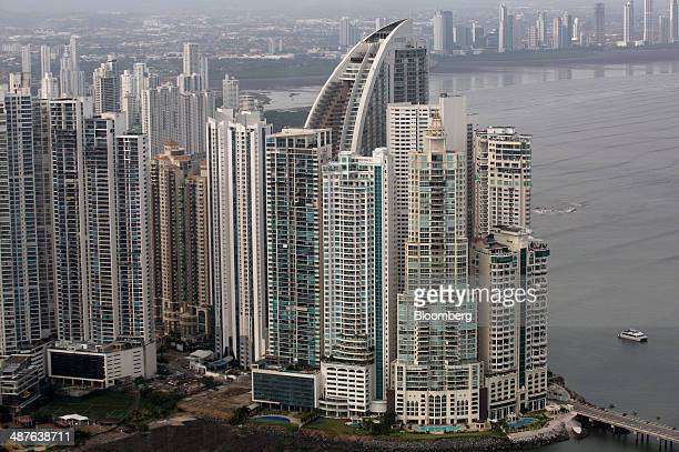 Buildings stand in the skyline including the Trump Ocean Club International Hotel Tower center right with curved roof in this aerial photo taken in...