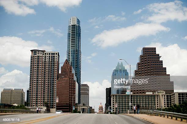 Buildings stand in the skyline of Austin Texas US on Friday June 6 2014 Localities in Texas home to seven of the nation's 15 fastestgrowing cities...