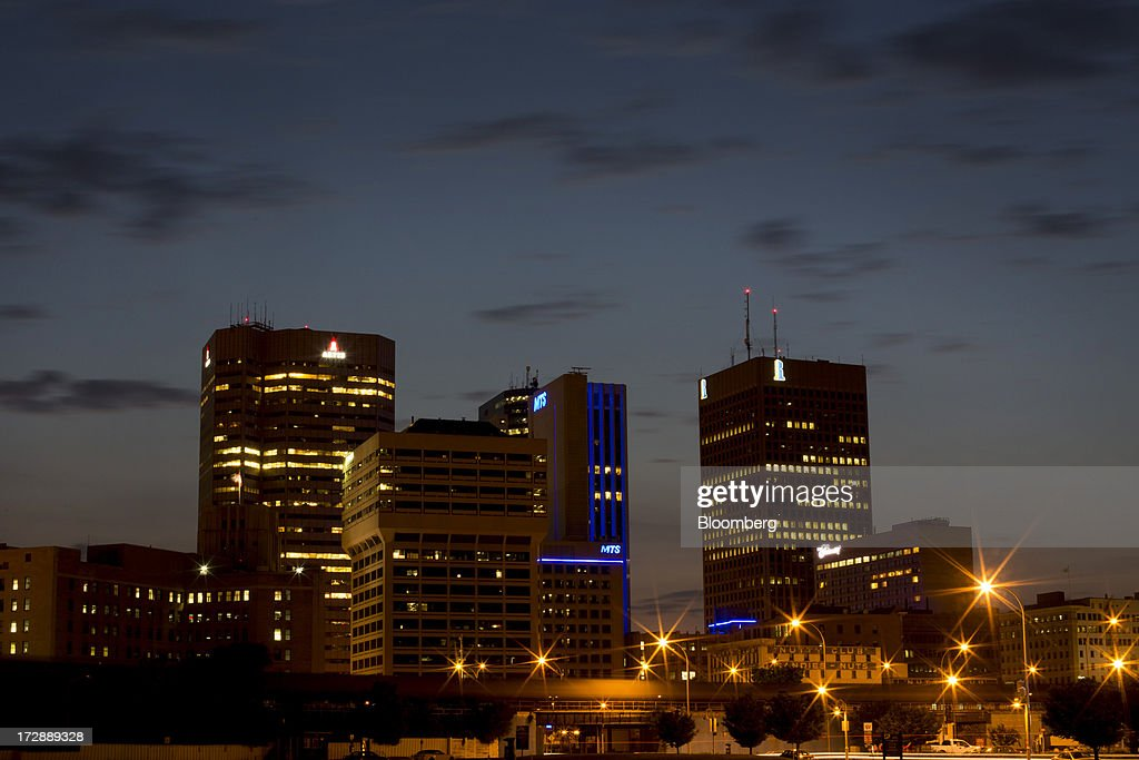 Buildings stand in the skyline of Winnipeg, Manitoba, Canada, on Thursday, July 4, 2013. Canada extended the longest streak of merchandise trade deficits in a quarter century in May, with the shortfall narrowing as imports fell faster than exports. Photographer: Brent Lewin/Bloomberg via Getty Images