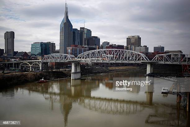 Buildings stand in the skyline past the Cumberland River in downtown Nashville Tennessee US on Saturday Feb 8 2014 Tennessee's state capital known as...