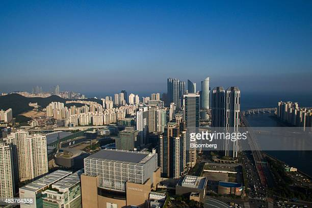Buildings stand in this aerial photograph taken above the Haeundae district in Busan South Korea on Friday July 31 2015 South Korea urged its people...