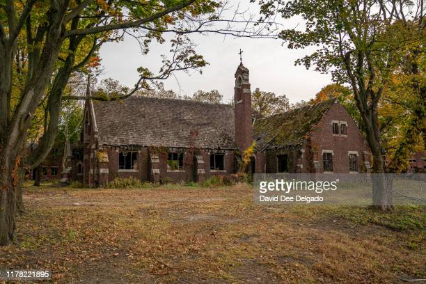 Buildings stand on the grounds of Hart Island, a former prison and Nike missile silo site which is now the largest public burial ground in the United...