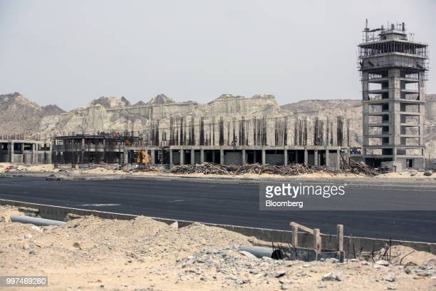 Buildings stand under construction at a development site operated by China Overseas Ports Holding Co near Gwadar Port in Gwadar Balochistan Pakistan...