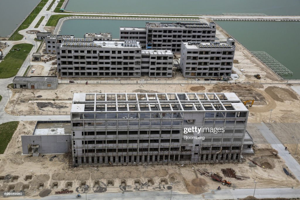 Buildings stand under construction at the Sahiwal coal power plant owned by China`s stateowned Huaneng Shandong Rui Group in Sahiwal Punjab Pakistan..