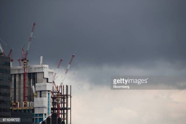 Buildings stand under construction in the central business district of Singapore on Wednesday June 13 2018 Tourism as well as the consumer sector...