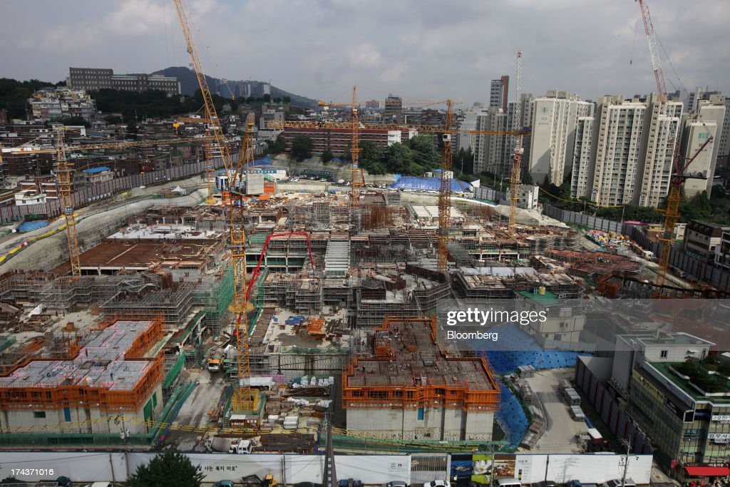 Buildings stand under construction in the district of Mapo in Seoul, South Korea, on Wednesday, July 24, 2013. South Koreas economy grew the most in more than two years, on stronger government spending and private consumption even as a slowdown in China clouds the outlook. Photographer: Woohae Cho/Bloomberg via Getty Images