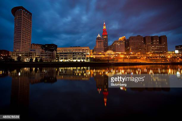 Buildings standing in the downtown skyline are reflected in the Cuyahoga River in Cleveland Ohio US on Saturday April 12 2014 Demand for manufactured...