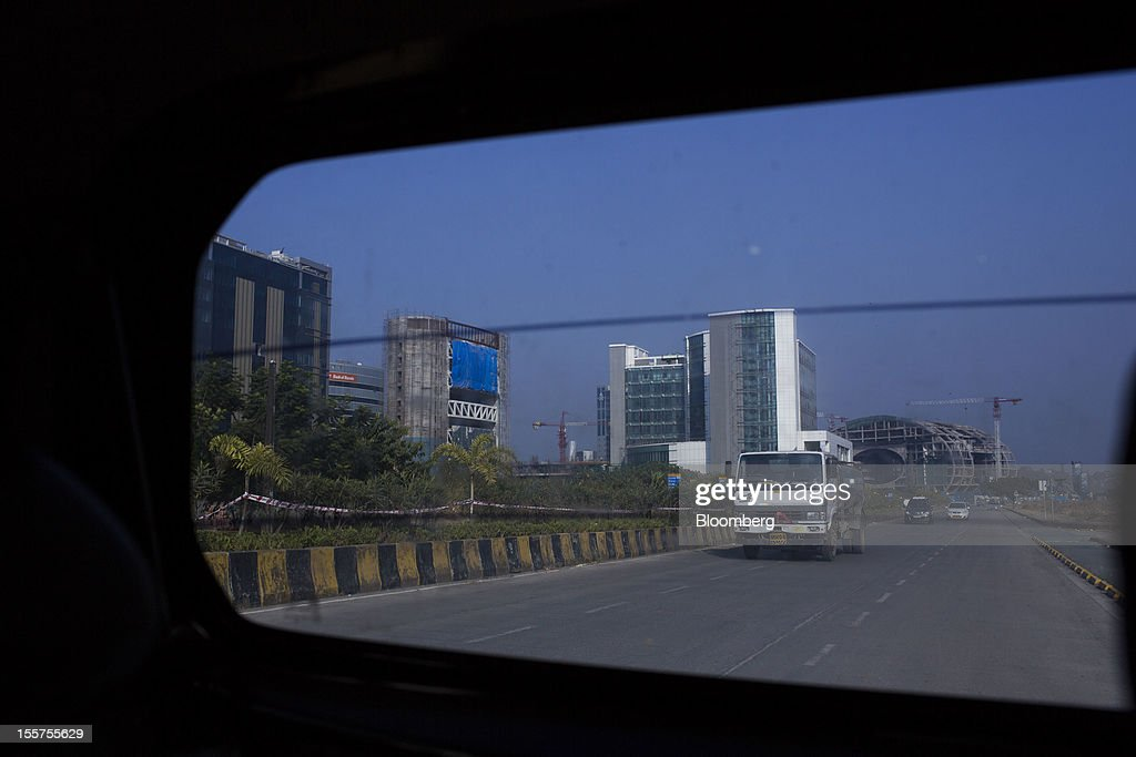 Buildings under construction are seen through a vehicle window in the Bandra Kurla Complex in Mumbai, India, on Tuesday, Nov. 6, 2012. Reserve Bank of India Governor Duvvuri Subbarao lowered the RBI's forecast for India's gross domestic product growth in the year through March to 5.8 percent, the slowest in almost a decade, from 6.5 percent. Photographer: Brent Lewin/Bloomberg via Getty Images