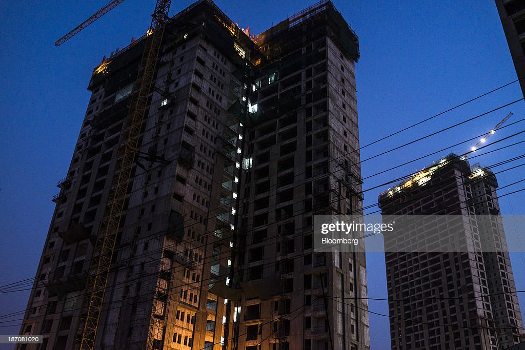 Buildings under construction stand in a Larsen & Toubro Ltd. construction zone in the Anandapur area of Kolkata, West Bengal, India, on Friday, Nov. 1, 2013. Indian stocks fell for the first time in six days, led by technology and consumer companies, after benchmark indexes climbed to records in a holiday trading session on Nov. 3. Photographer: Sanjit Das/Bloomberg via Getty Images