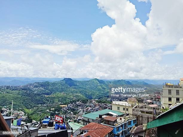 buildings with mountains in background - guwahati stock photos and pictures