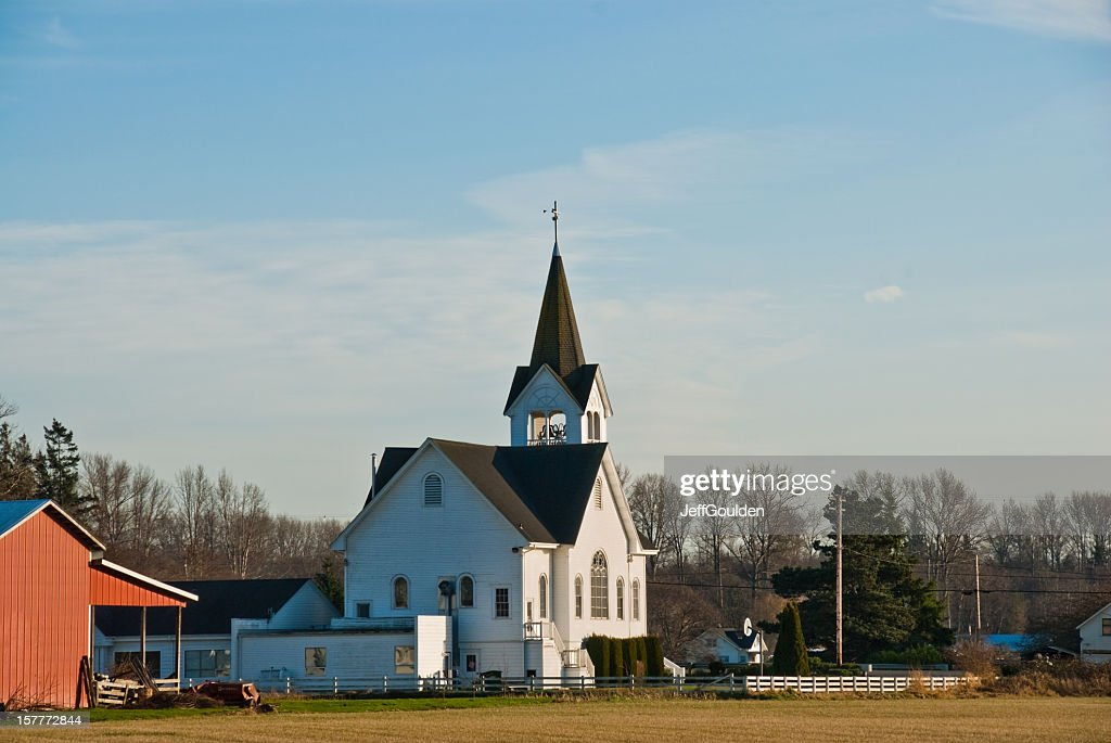 Historic White Church and Red Barn : Stock Photo