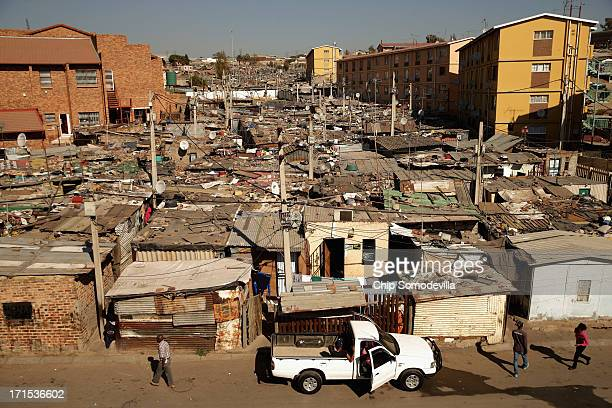 Built in a haphazard swath shacks stretch on to the horizon in Alexandra Township June 26 2013 in Johannesburg South Africa A township with a wide...