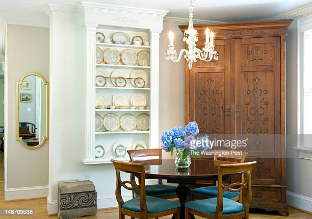 A built in cabinet to display china and crown molding adorn the original part of the house where the dining room and living room share the space...