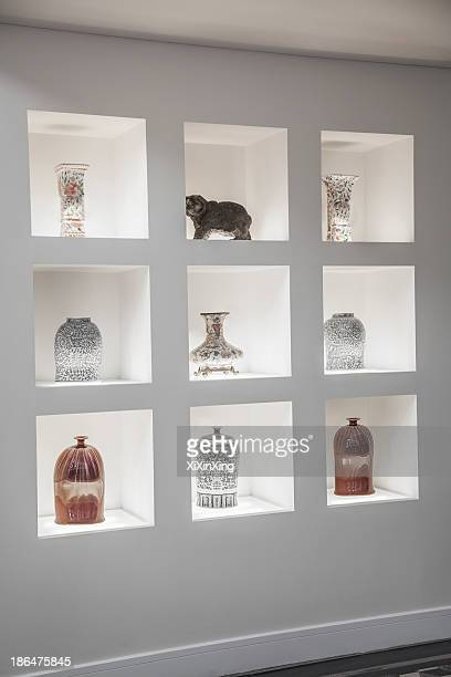 Built in shelves with an assortment of vases.