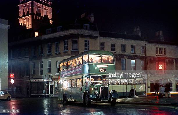 CONTENT] 1955 built KSW No8266 of Bath Services is shown in Bath on 24/7/70 Bath Abbey rises up above the shops