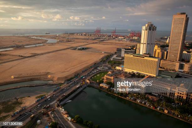 Built on land reclaimed from the Indian Ocean and funded with $14billion in Chinese investment the Colombo Port City project is seen jutting out into...