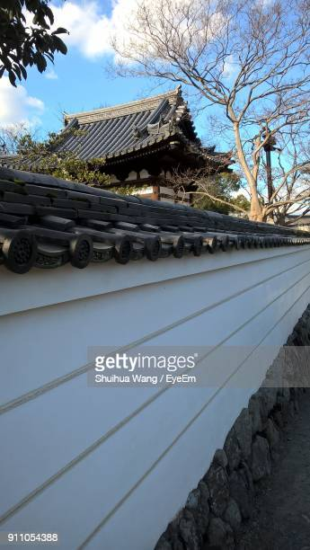 built structure against sky - uji kyoto stock pictures, royalty-free photos & images