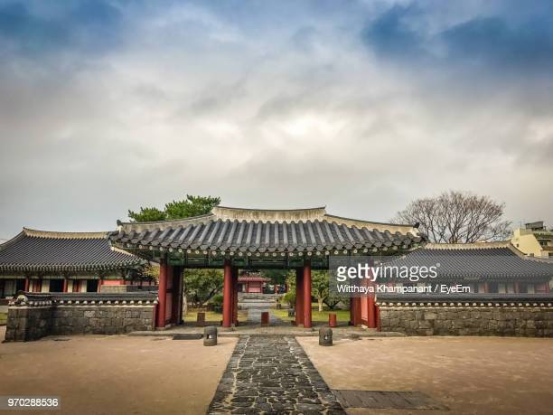 built structure against sky - jeju stock photos and pictures
