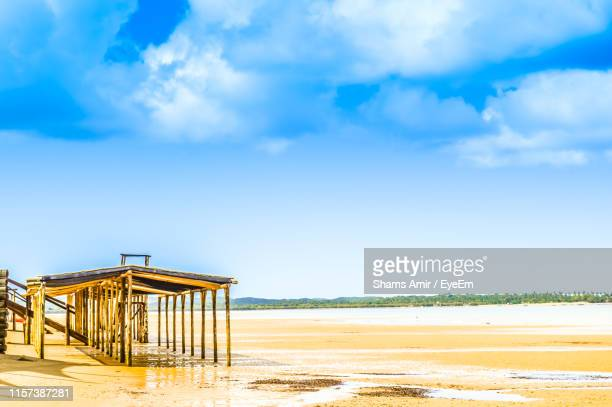 built structure at beach against sky - maputo city stock pictures, royalty-free photos & images