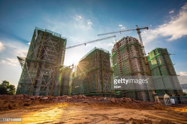 built structure at sunset - construction industry stock pictures, royalty-free photos & images