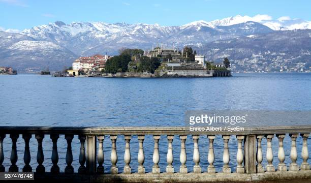 built structure by sea against sky - stresa stock pictures, royalty-free photos & images
