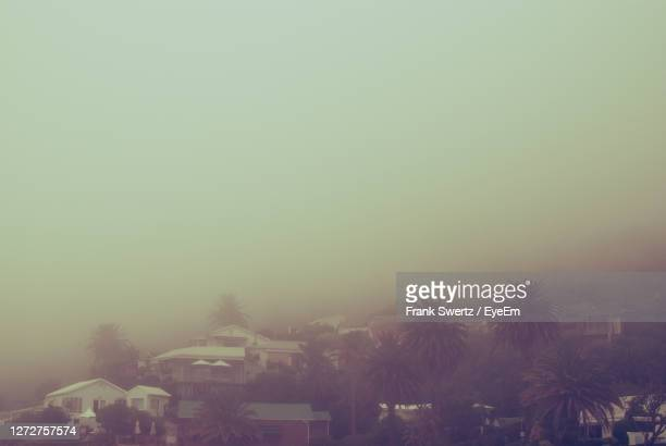built structure in foggy weather - frank swertz stock pictures, royalty-free photos & images
