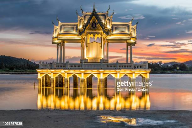 built structure in water during sunset - prachuap khiri khan province stock pictures, royalty-free photos & images
