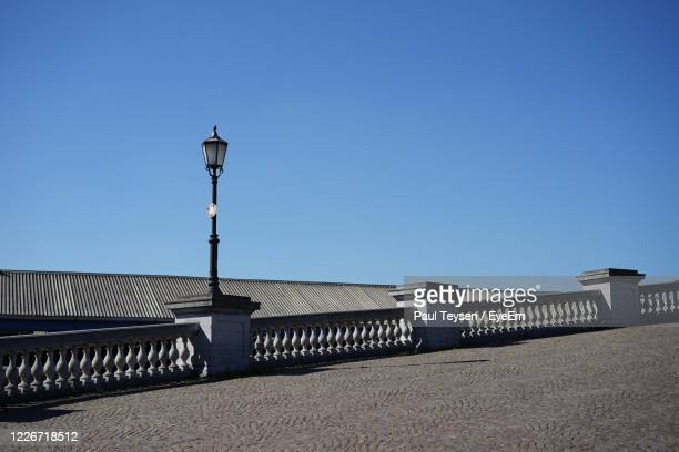 built structure on beach against clear blue sky - belgium stock pictures, royalty-free photos & images