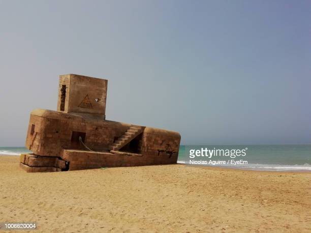 Built Structure On Beach Against Clear Sky
