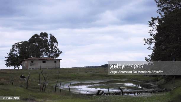 Built Structure On Countryside Landscape Against Clouds