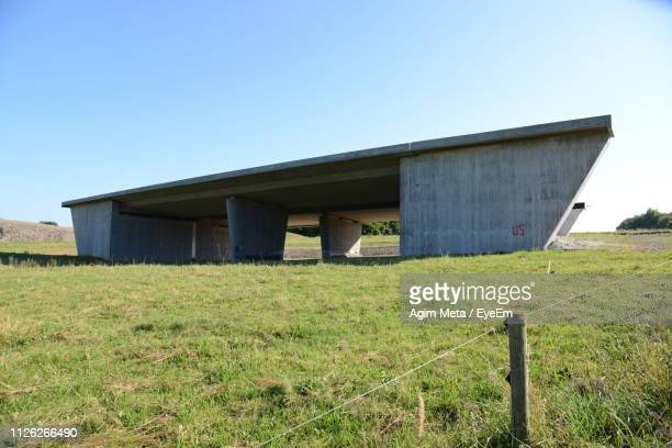 built structure on field against clear sky - agim meta stock pictures, royalty-free photos & images