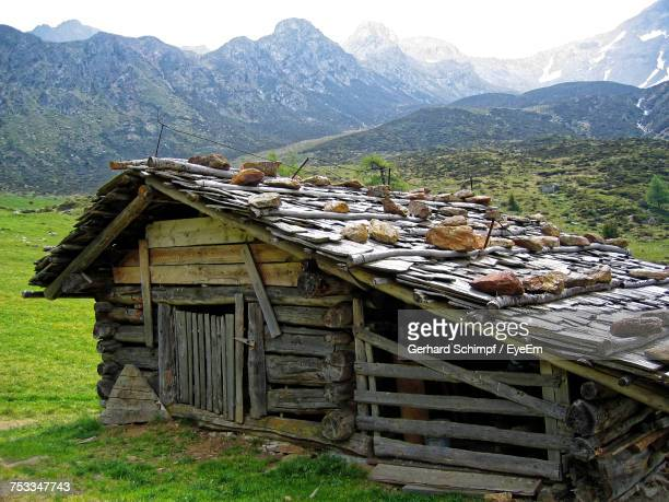 built structure on field against mountains - gerhard schimpf stock pictures, royalty-free photos & images