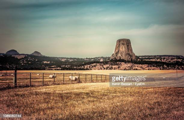 built structure on field against sky - kenin stock pictures, royalty-free photos & images