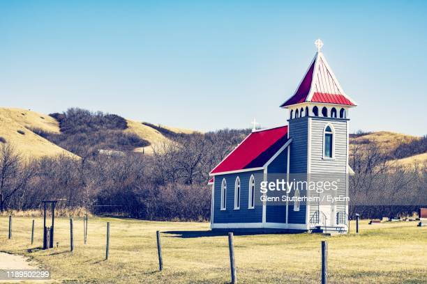 built structure on field by buildings against sky - stutterheim stock pictures, royalty-free photos & images