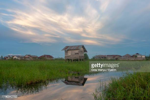 built structure on field by buildings against sky - central kalimantan stock pictures, royalty-free photos & images