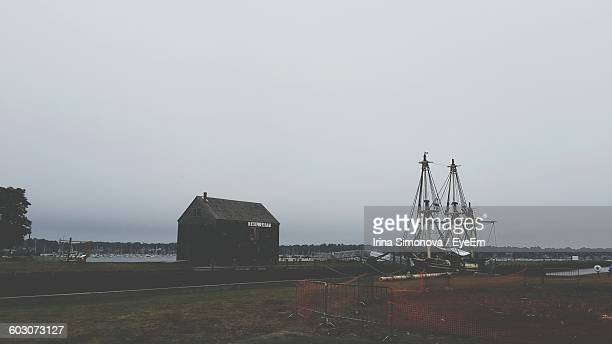 built structure on landscape against clear sky - salem massachusetts stock pictures, royalty-free photos & images
