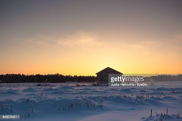built structure on snow landscape - heinovirta stock pictures, royalty-free photos & images