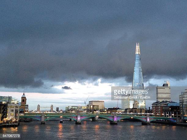 built structures against sky with waterfront - greater london stock pictures, royalty-free photos & images