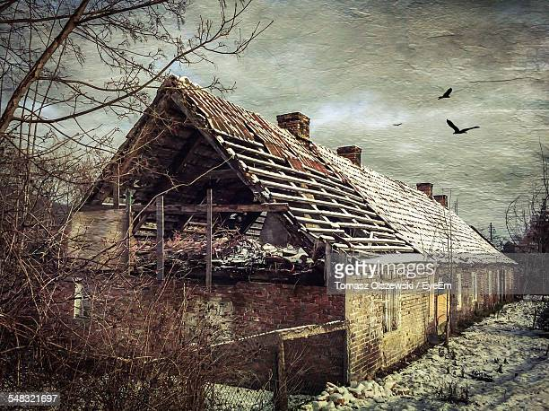 built structures on landscape against the sky - pomorskie province stock photos and pictures