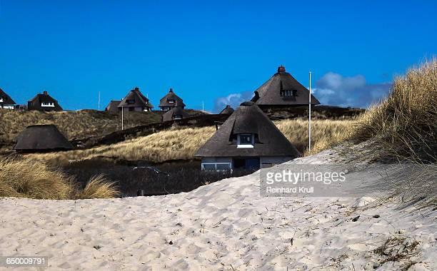 Built Structures On Shore Against Blue Sky